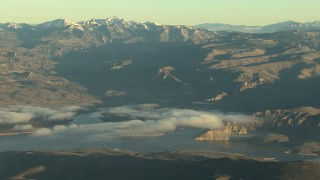 HDA13_415 - HD stock footage aerial video of the Blue Mesa Reservoir and the Rocky Mountains at sunrise, Colorado