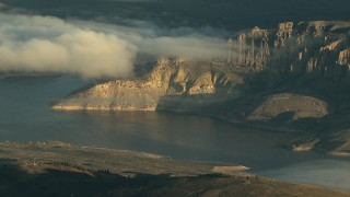 HDA13_415_01 - HD stock footage aerial video of low clouds over the Blue Mesa Reservoir at sunrise, Colorado