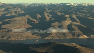 HDA13_416 - HD stock footage aerial video of flying by the Blue Mesa Reservoir and Rocky Mountains at sunrise, Colorado
