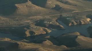 HDA13_417 - HD stock footage aerial video of piers on the Blue Mesa Reservoir at sunrise, Colorado