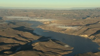 HDA13_419 - HD stock footage aerial video of the Blue Mesa Reservoir and Rocky Mountains at sunrise, Colorado