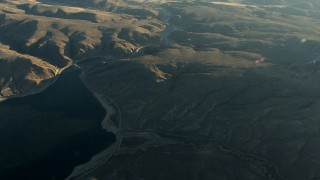 HDA13_421 - HD stock footage aerial video tilt from the Blue Mesa Reservoir at sunrise to reveal the town of Gunnison, Colorado