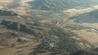 HDA13_424 - HD stock footage aerial video of approaching the town of Gunnison at sunrise, Colorado