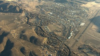 HDA13_426 - HD stock footage aerial video approach the small town of Gunnison at sunrise, Colorado