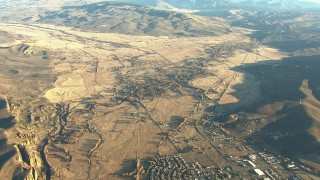 HDA13_427 - HD stock footage aerial video tilt from Gunnison to reveal farms and mountains at sunrise, Colorado