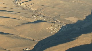 HDA13_428 - HD stock footage aerial video of a sparsely populated rural area at sunrise, Gunnison, Colorado