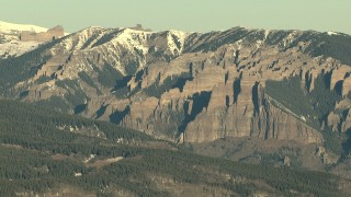 HDA13_430 - HD stock footage aerial video of steep and jagged slopes with snow at sunrise, Rocky Mountains, Colorado