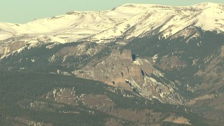 HDA13_434 - HD stock footage aerial video of the snow-capped Rocky Mountains at sunrise, Colorado