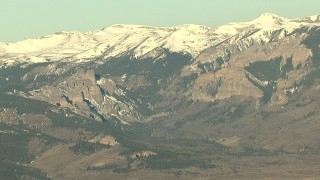 HDA13_435 - HD stock footage aerial video of snow-capped Rocky Mountains at sunrise, Colorado