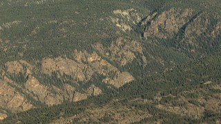 HDA13_439 - HD stock footage aerial video of a canyon through hills at sunrise, Rocky Mountains, Colorado
