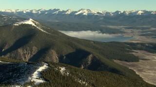 HDA13_440_03 - HD stock footage aerial video of panning across the mountains at sunrise and reveal reservoir, Rocky Mountains, Colorado
