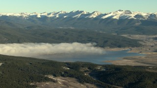 HDA13_441 - HD stock footage aerial video of fog on the Taylor Park Reservoir at sunrise near the Rocky Mountains, Colorado