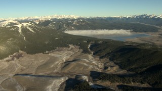 HDA13_442 - HD stock footage aerial video of a reservoir with fog at sunrise, surrounded by the Rocky Mountains, Colorado