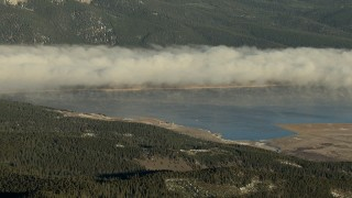 HDA13_443 - HD stock footage aerial video of fog over the Taylor Park Reservoir at sunrise, Colorado