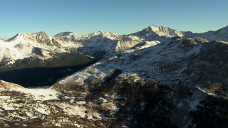 HDA13_446 - HD stock footage aerial video of flying by the Rocky Mountains with snow at sunrise, Colorado