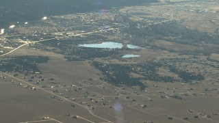 HDA13_451 - HD stock footage aerial video of the town of Buena Vista and lakes at sunrise, Colorado