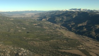 HDA13_452 - HD stock footage aerial video of rural homes at sunrise at the base of mountains, Buena Vista, Colorado