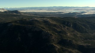 HDA13_454 - HD stock footage aerial video of flying over rounded slopes at sunrise in the Rocky Mountains, Colorado