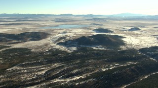 HDA13_458 - HD stock footage aerial video of flying over hills toward a reservoir in Park County, Colorado