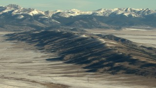 HDA13_463 - HD stock footage aerial video of a ridge and snowy Rocky Mountains in Park County, Colorado