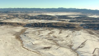 HDA13_465 - HD stock footage aerial video of approaching hills with light snow in Park County, Colorado