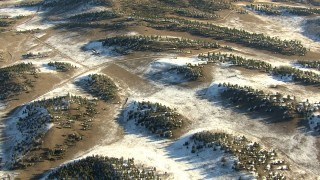 HDA13_468 - HD stock footage aerial video of flying over rounded hills and patches of snow in Park County, Colorado