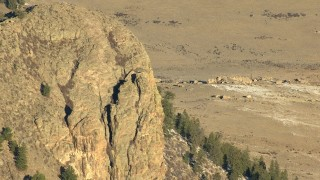 HDA13_471_01 - HD stock footage aerial video of a close-up of a steep summit of a peak in the Rocky Mountains, Colorado