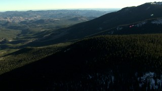 HDA13_475 - HD stock footage aerial video of flying over trees and on mountains with snow patches in the Rocky Mountains, Colorado