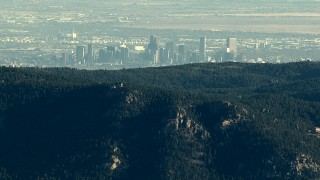 HDA13_477_01 - HD stock footage aerial video of the Downtown Denver skyline seen from a ridge in the Rocky Mountains, Colorado