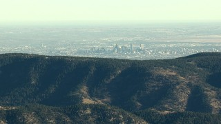 HDA13_480_01 - HD stock footage aerial video of Denver's skyline seen from the Rocky Mountains, Colorado, zoom to wider view