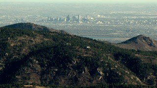 HDA13_482_01 - HD aerial stock footage video of a view of Downtown Denver and the lake seen from the Rocky Mountains, Colorado