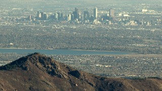 HDA13_482_02 - HD stock footage aerial video of Downtown Denver and Marston Lake seen from the Rocky Mountains, Colorado