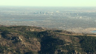 HDA13_482_03 - HD stock footage aerial video zoom wider from Downtown Denver and Marston Lake, reveal the Rocky Mountains, Colorado