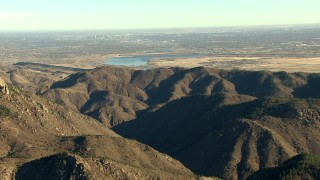 HDA13_482_04 - HD stock footage aerial video of reservoirs and the Rocky Mountains, zoom tighter on Downtown Denver, Colorado