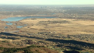 HDA13_483 - HD stock footage aerial video of Denver, reservoir, and Roxborough Park seen from Rocky Mountains, Colorado