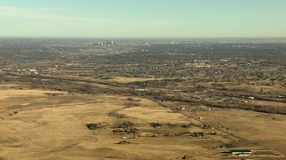 HDA13_484 - HD stock footage aerial video of the Downtown Denver skyline and surrounding suburbs in Colorado