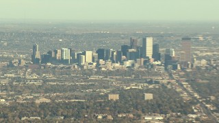 HDA13_485_01 - HD stock footage aerial video of skyscrapers in Downtown Denver, zoom to reveal suburbs, Colorado