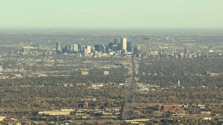HDA13_485_02 - HD stock footage aerial video of Downtown Denver and suburbs, and zoom to a wider view, Colorado