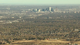 HDA13_485_04 - HD stock footage aerial video of zooming to a closer view of Downtown Denver and suburbs in Colorado