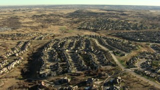 HDA13_486_01 - HD stock footage aerial video of flying over tract homes and mansions in Castle Pines, Colorado