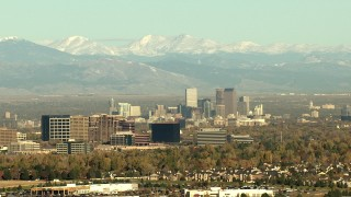 HDA13_488_02 - HD stock footage aerial video of Centennial office buildings, Downtown Denver skyscrapers and Rocky Mountains, Colorado