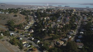 JDC01_033 - 5K stock footage aerial video fly over suburban tract homes, reveal Valero Oil Refinery, Benicia, California