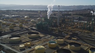 JDC01_037 - 5K stock footage aerial video of flying by Valero Oil Refinery buildings, Benicia, California