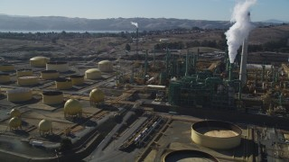 JDC01_038 - 5K stock footage aerial video of flying by Valero Oil Refinery buildings, Benicia, California