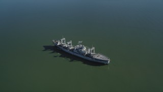 JDC01_040 - 5K stock footage aerial video of flying by a National Defense Reserve Fleet warship, Suisun Bay, California