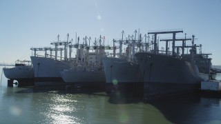 JDC01_044 - 5K stock footage aerial video of flying by National Defense Reserve Fleet warships, Suisun Bay, California