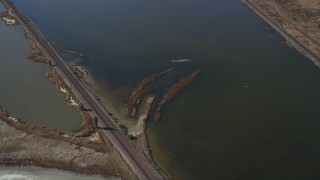 JDC01_059 - 5K stock footage aerial video of flying away from railroad tracks, marshlands, Martinez, California