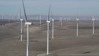 JDC01_067 - 5K stock footage aerial video of flying by windmills at Shiloh Wind Power Plant, Montezuma Hills, California
