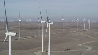 JDC01_068 - 5K stock footage aerial video of flying by field of windmills, Shiloh Wind Power Plant, Montezuma Hills, California