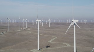 JDC01_069 - 5K stock footage aerial video of flying by Shiloh Wind Power Plant windmills, Montezuma Hills, California